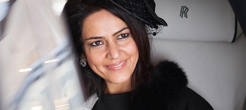 Kavita Oberoi sat inside a Rolls-Royce
